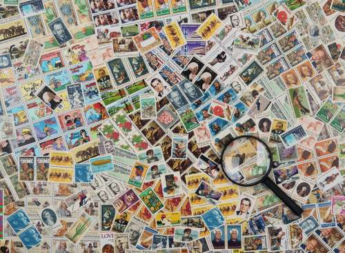 Stamps (RB14805-9), a 500 piece jigsaw puzzle by Ravensburger. Click to view larger image.